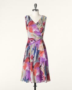 Chiffon sculpts the shape, flowing from V-neckline to side-shirred waist, with a party ruffle for fun. Coldwater Creek.