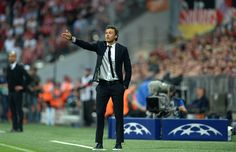 Barcelona's coach Luis Enrique gestures during UEFA Champions League semi-final second leg football match FC Bayern Munich vs FC Barcelona in Munich, southern Germany, on May 12, 2015.