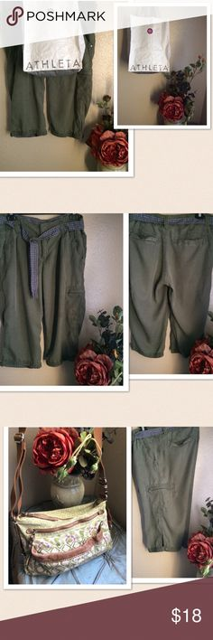 "Athleta Cargo Capri Pants Athleta belted Lyocell Pants. Cargo Capri design. Removable belt. Adjustable snap button at the legs. Material: 💯% lyocell. Size: 10. Length: 27"", seam: 18"". Color: Light Army Green. Preowned. Excellent condition. Athleta Pants Capris"