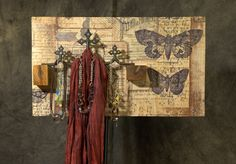 At The Timeless Material Co. in Waterloo, Ontario, I found some metal fence toppers.  They were covered in rust and old bits of (probably) lead paint.  I stripped them but left a bit of grunge on them.  They are mounted on a board with decoupaged fabric and wooden blocks.  It is a great piece to display scarves and jewelry. Waterloo Ontario, Lead Paint, Metal Fence, Wooden Blocks, Architectural Salvage, Old And New, Rust, Repurposed, Grunge