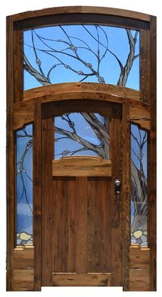 Beautiful solid wood front door with custom stained glass! Sidelight windows and large transom window of stained glass and wrought iron.