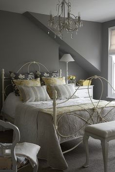 Gray bedroom with yellow accents- love the bed and the chandelier!!! This room is so inviting! #Interior #Design #ideas