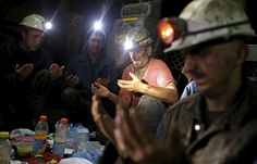 Coal miners pray as they break their fast during the holy month of Ramadan, 2427 feet deep inside the Stara Jama coal mine, in Zenica, Bosnia and Herzegovina, July 15, 2015. Picture taken July 15. REUTERS/Dado Ruvic
