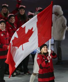 Hayley Wickenheiser - Canadian Flag Bearer,  Sochi, 2014- photo The Star