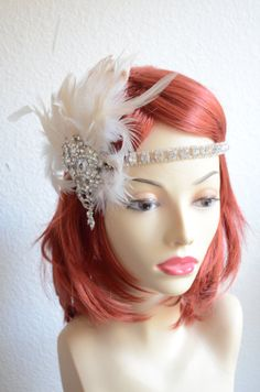 Ivory and Champagne feather headpiece with stunning large brooch and crystal band.