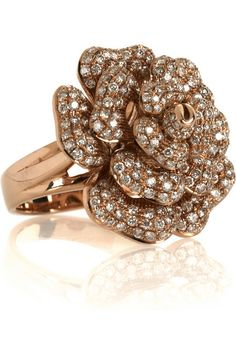 i was trying to find a rose gold ring for my Mommy Lizette when I found this! I love it. Many may not know but im obsessed with flower rings. especially rose rings. this one is made of 18k of rose gold and 2.01k white diamonds!! Love love love!