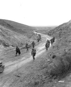 The 2nd Battalion, 16th Infantry Regiment of the United States Army marches through the Kasserine Pass and on to Kasserine and Farriana. Tunisia, 26 February, 1943.