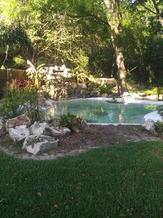 Large backyard koi pond with waterfall and bridge