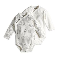 Soft organic cotton bodysuits with push buttons along one side and to the crotch.