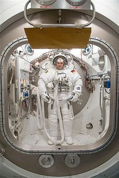 European Space Agency astronaut Alexander Gerst participates in an Extravehicular Mobility Unit spacesuit fit check in Houston on Dec. 10