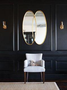 Paneled walls. / http://www.apartmenttherapy.com/dark-drama-black-and-gold-178887