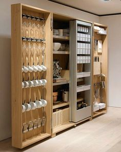 This cabinet would save so much space in the kitchen. Everything would be in one place. Maybe we could build something similar.