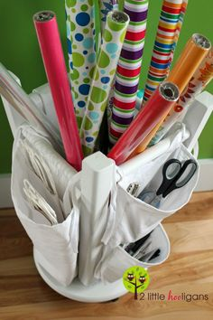 IHeart Organizing: Reader Space: That's a Wrap! Wrapping Paper Organizer made from a stool turned upside down--genius!!