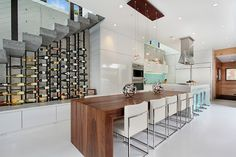 Creative custom wine rack can enliven the space under the stairs [From: Jeri Koegel Photography]