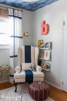 We love this chic, modern take on a nursing corner in the nursery!
