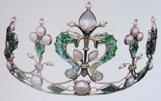 Scottish tiara of silver, enamel, and freshwater pearls - graduated plant motifs with two dolphins on either side of the tall central plant motif by James Cromer Watt, c 1900