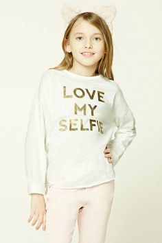"""Forever 21 Girls - A slub knit tee featuring a metallic """"Love My Selfie"""" graphic, long sleeves, a round neckline, side slits, and a raw-cut hem."""
