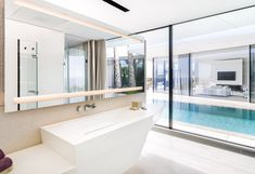 PORCELANOSA Grupo Projects: dematerialised architecture through Krion® in a house in Majorca Modern Pool House, Modern Pools, Bad Inspiration, Bathroom Inspiration, Home Projects, Design Projects, Red Dot Design, Loft, Dream House Exterior