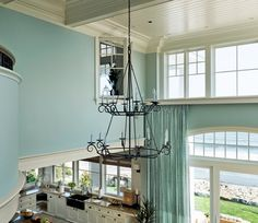 This absolutely incredible beach home designed by TMS Architects was built on the top of a high bluff overlooking the Atlantic in Hampton, New Hampshire.  its casually elegant, full of serene color (Sherwin Williams Sea Salt!)