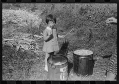 "Mountaineer's daughter enjoying the sorghum syrup at a neighbor's home during a ""syrupping off,"" Breathitt County, Kentucky. 1940. Library of Congress."