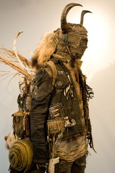 "Distressed, dusty look.  Natural ""found"" elements: bone, feathers, fur, leather."