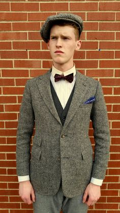 Closer view of the torso of the suit, this time with the jacket buttoned. Note the extremely fitted nature of the jacket, almost to the point of being too small by today's standards. As can clearly be seen here, the style was commonly that of a very high, fitted jacket waist and narrow, almost feminine shoulders. The ticket pocket can also be better seen on the left side of the jacket.