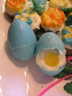 """Hollow eggs made with blue-tinted white chocolate...the """"egg white"""" is homemade cheesecake and the """"yolk"""" is a little circle of mango (that flavor combo was great!). I should have worked on removing the seam from when I made the egg, but I was running short on time :-\"""