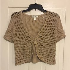 Brown crocheted shrug This shrug is a crocheted pattern with a detailed front. Very simple but would compliment any outfit! Dress Barn Sweaters Shrugs & Ponchos