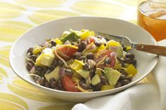 Cumin, black beans, avocados and Tex Mex cheese - sounds like the start to a Mexican-inspired recipe.  Add in some tomatoes, peppers and onions and you've got our Mexican Chopped Salad.