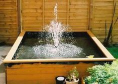 pond in a raised bed Small Garden Ponds Pinterest Small