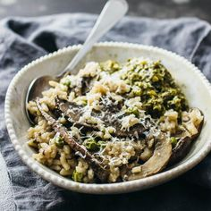 Try this easy vegetarian recipe for creamy pesto risotto with portobello mushrooms and green peas, topped with finely grated asiago cheese.