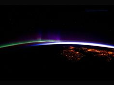 Horizon (night lights of the cities of Ireland, in the foreground, and the United Kingdom, in the back and to the right, are contrasted by the bright sunrise in the background. The greens and purples of the Aurora Borealis are seen along the rest of the horizon.)   Image Credit: NASA