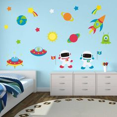 This space wall stickers set features a bright and colourful space scene, ideal for brightening up any child's nursery, bedroom or playroom.This space wall stickers set includes astronauts, planets, stars, a rocket, an alien, flags, earth, the sun and spaceships. Fitting is extremely simple as all you need to do is peel and stick each piece in place. This fabric wall sticker set can be applied to any smooth surface including painted walls, glass, mirrors and furniture.This space wall…