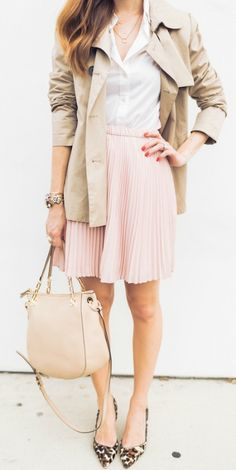 This pink skirt paired with a white skirt and patterned pumps gives the ideal balance between a cute yet elegant outfit. Via Mara Ferreira Coat: Nordstrom, Shirt: J Crew, Skirt: Banana Republic, Heels: J Crew