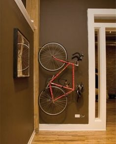 Narrow, unused wall space is ideal for bicycle storage. | Shared by velojoy.com