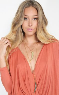 Such a subtle statement necklace. The sabre tooth pendants are a great touch to a v-neck top.   MakeMeChic.com