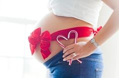 Cute maternity picture for Christmas - @Angela Gray Kudurogianis I like this one too :):)