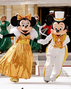 Mickey and Minnie Mouse show their skati