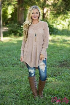 This cozy sweater is sure to keep you warm all season long! Featuring a soft almond brown, the color is so perfect for fall - and did we mention the soft knit material? It's so perfect for wrapping up and staying cozy on the couch at Thanksgiving or Christmas!