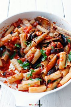 Pasta alla Norma - classic Sicilian Pasta Dish made with Aubergine, Tomatoes, Basil and Baked Ricotta Cheese