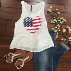 """American Heart Tank American Heart White Tank! Loose Comfortable Fit! Super Cute for Summertime and 4th of July! 95% Rayon 5% Spandex. Made in USA!  Sizes Available: S,M,L  ✨Use the """"Buy Now"""" or """"Add to Bundle"""" Button to select your size for Purchasing✨ Tops Tank Tops"""