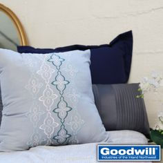 We love how accent pillows can make any bed look and feel glamorous. Too expensive? Think again! We found all of these like new or new with tag pillows for only $3.99 each at Goodwill!