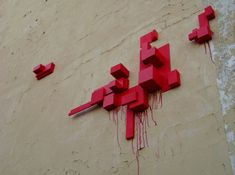 polish graffiti sculptures by truth.  the works are made from polystyrene that is  stuck onto urban walls and other surfaces, playing off the architecture in a perpendicular way.