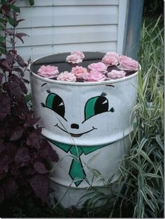 How to decorate the barrels. Flower Planters, Flower Pots, Planter Pots, Water Barrel, Rain Barrel, Flower Pot Crafts, Clay Pot Crafts, Garden Crafts, Garden Art