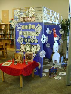 """A Good Book Brings Great Joy"" is a lovely title for a holiday reading display.  From:  Shelf Mouse"