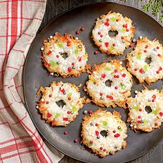 Wreath Macaroons | Use your fingers to make a small hole in the center of each cookie.