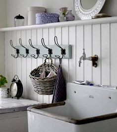 rustic inspiration - for the downstairs laundry. Wood paneling can be made to look tolerable. totally doing this for our laundry/ kitchenette! Laundry Room Sink, Farmhouse Laundry Room, Laundry Rooms, Laundry Area, Mud Rooms, Laundry Cabinets, Laundry Decor, Small Laundry, Vintage Sink