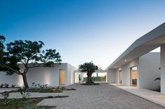 Completed in 2012 in Tavira, Portugal. Images by Joao Morgado. Context South of Portugal, Algarve, Tavira. Here the ocean peeks, while the 400 olive trees surround the house. An old building has to give place to. Space Architecture, Residential Architecture, Contemporary Architecture, Building Architecture, Tavira Portugal, Design Exterior, Architectural Photographers, Architect House, House Design