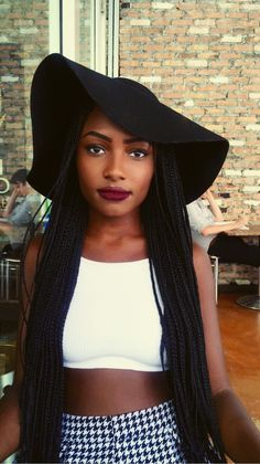 """A beautiful sister rocking the """"Clueless"""" look. 20""""+ of Braids and a floppy hat are the staples for this style.  @kyyraax"""