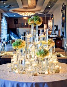 Wedding reception tables cape of floating candles and florals. Vases, Candle Centerpieces, Floral Centerpieces, Vase Arrangements, Centerpiece Ideas, Flower Arrangement, Wedding Reception Centerpieces, Wedding Table Decorations, Wedding Ceremony